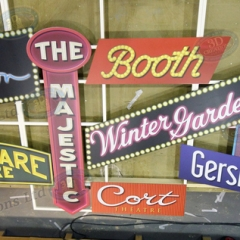 Printed-signs-attached-to-fabricated-metal-frame